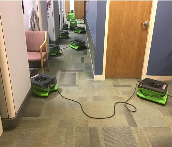 green SERVPRO drying equipment in office space