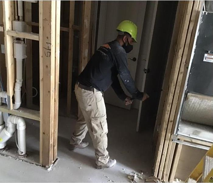 technician removing drywall