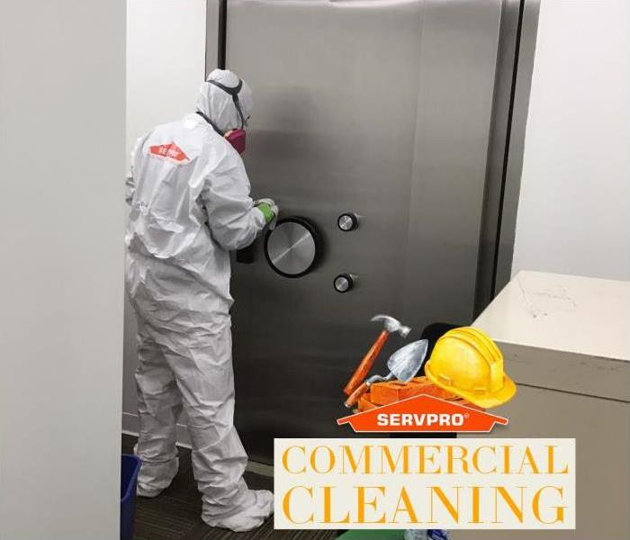 suited technician cleaning commercial building