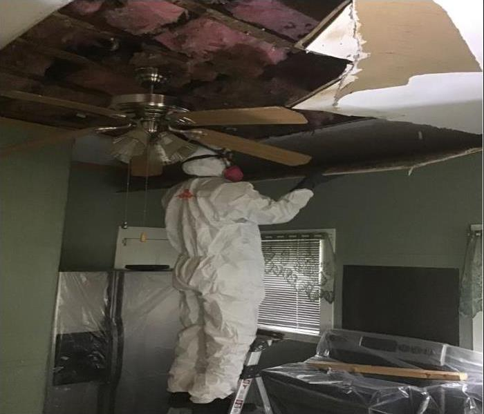 insulation in ceiling exposed due to water damage