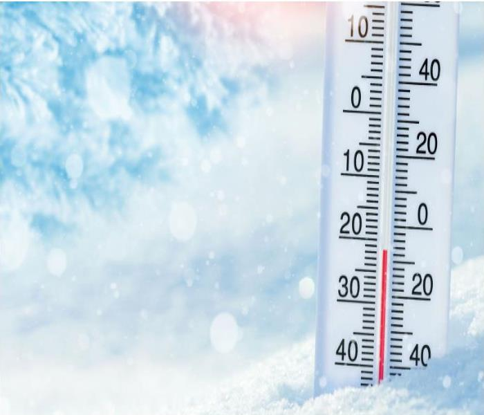 image of thermometer in snow