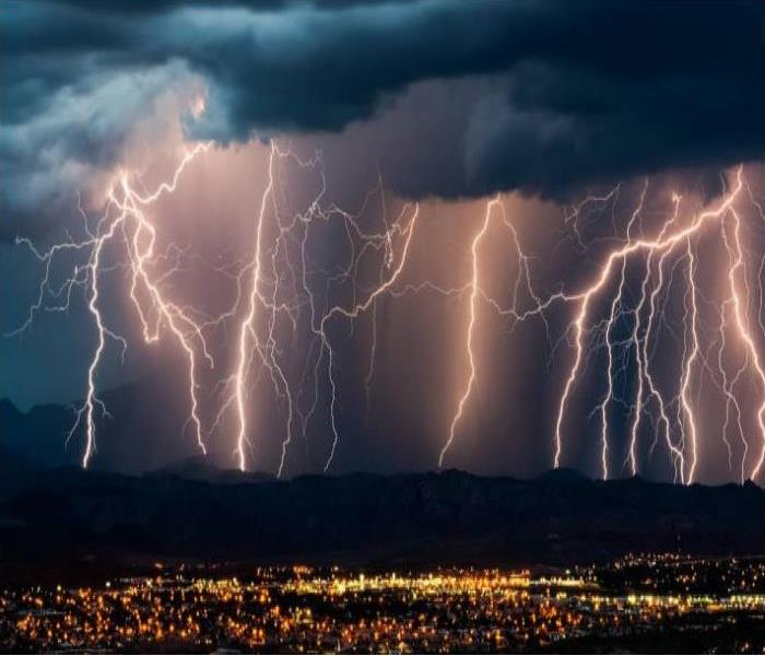 image of lightening and city skyline during a storm