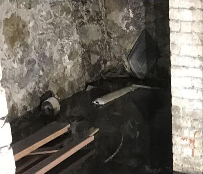 small crawl space filled with contaminated water from heavy rain
